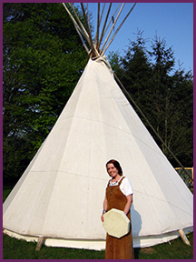 molly larkin in front of tipi
